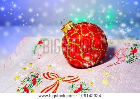 Red Christmas Ball On A Napkin. Christmas Decorations.
