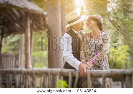 Attractive 1920s Dressed Romantic Couple on Wooden Bridge.
