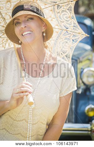 Beautiful 1920s Dressed Girl with Parasol Near Vintage Car Portrait.