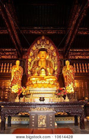 Buddhist Temple. Golden statue of Buddha