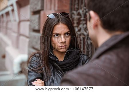 Young couple having an argument outdoors