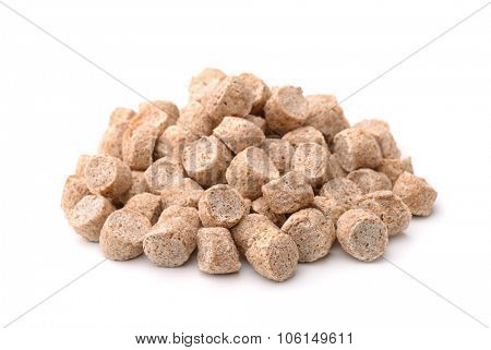 Extruded wheat bran isolated on white