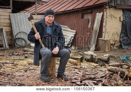 Mature man with an axe