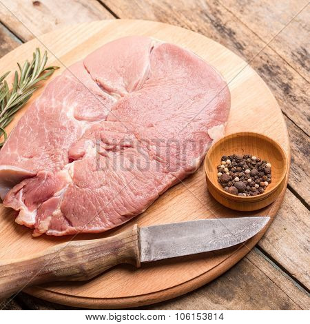 Chunk Of Meat With Knife And Pepper