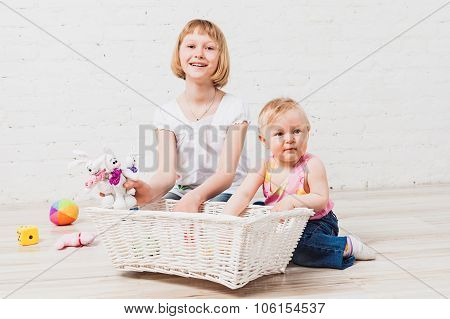 Happy children playing with soft toys