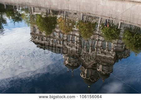 Reflection of church in water