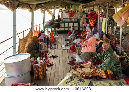 BAGAN, MYANMAR, JANUARY 22, 2015 : The Burmese passengers are waking up in the morning on the boat's deck going from Mandalay to Bagan in Myanmar (Burma).