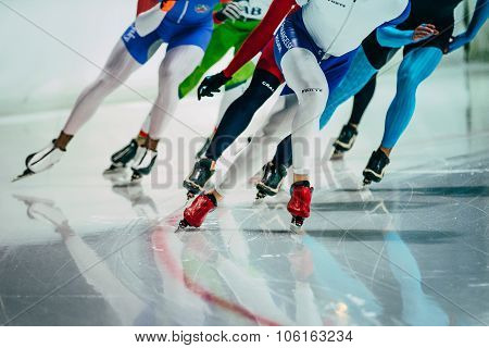 group of female speed skaters warm up before starting
