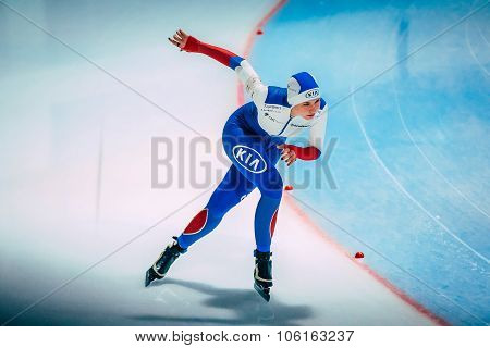 girl speed skaters runs a turn on ice