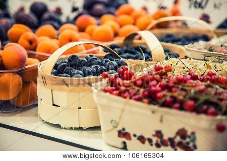 Berry fruits at a marketplace Blueberries raspberries strawberries cherries Forest fruits. Gardening