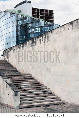 Comercial building, cinder block or brick wall texture with walkway and stair
