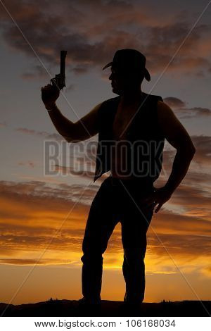 Silhouette Of A Cowboy With A Pistol Held Up