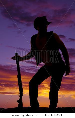 Silhouette Of Cowboy With Shotgun Funny Pose In Sunset