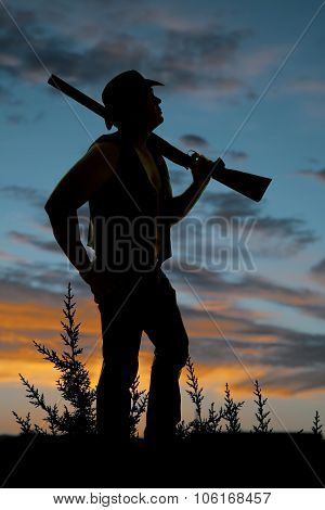 Silhouette Of Cowboy With Shotgun Over Shoulder Sunset