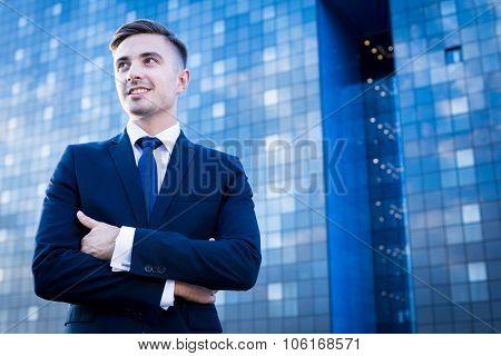 Businessperson And Blue Skyscraper