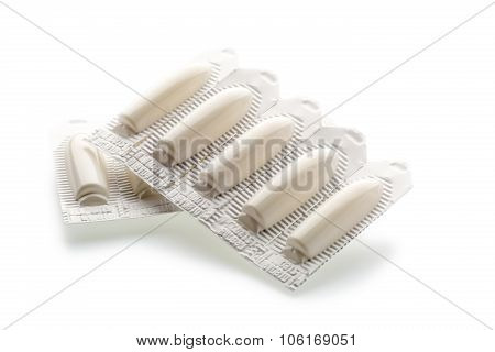 Vaginal suppository tablet in plastic strip pack