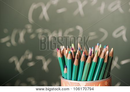Back to school background with tablet pencils