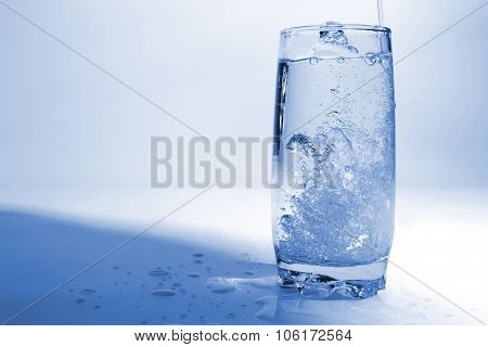 Water Drops In Transparent Glass With Bubbles Of Air