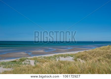 Beach With Low Tide Water