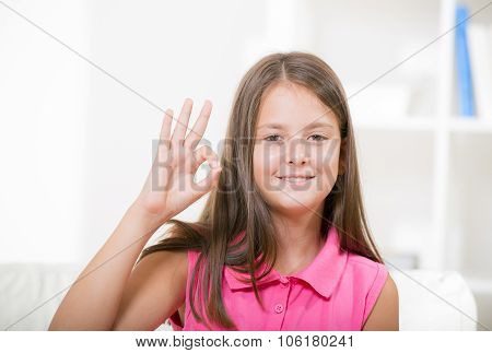 Beautiful smiling deaf girl using sign language