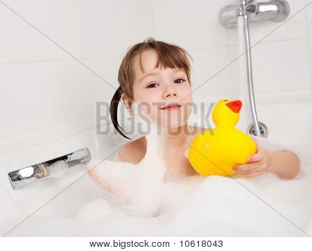 Little Girl Taking A Bath