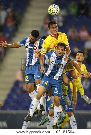 BARCELONA - OCT, 3: Bernardo Espinosa(Yellow) of Sporting Gijon during a Spanish League match against RCD Espanyol at the Power8 stadium on October 3 2015 in Barcelona Spain
