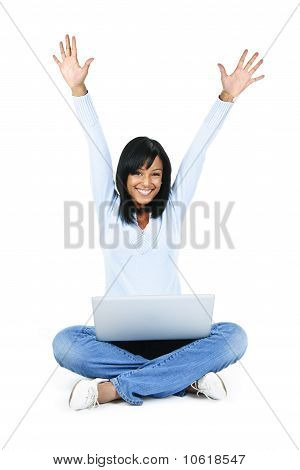 Happy Woman With Computer Rasing Arms