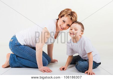 Son and his mother sitting together and smiling