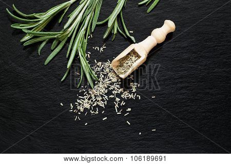 Fresh And Dry Rosemary On A Slate Plate