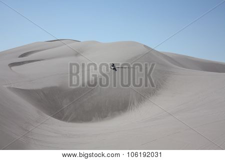 Lone rider at St Anthony sand dunes in Idaho