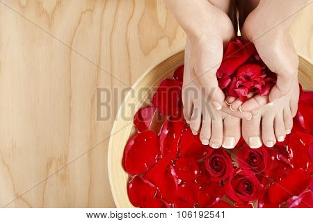 Pedicure Manicure Spa Treatment With Red Roses Wood Background