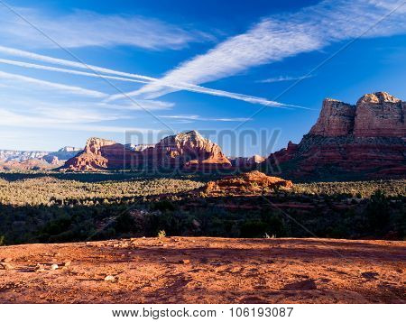 The view of Cathedral Rock in Sedona, Arizona. The towering rock formations stand out like beacons in the dimmed landscape of the Red Rock State Park.