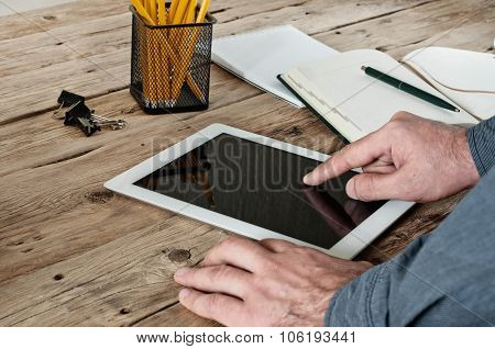 Male Hand Clicks On A Blank Screen Tablet Computer Closeup