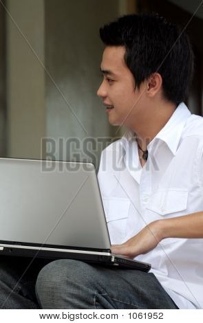 Asian Male With Laptop