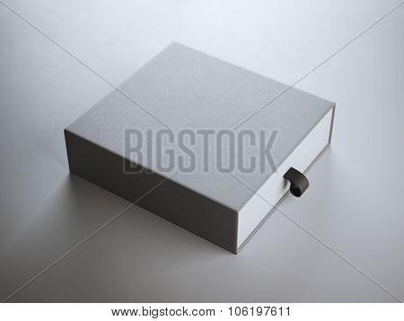 Square gray box in white studio