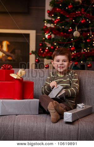Happy Boy Opening Christmas Presents