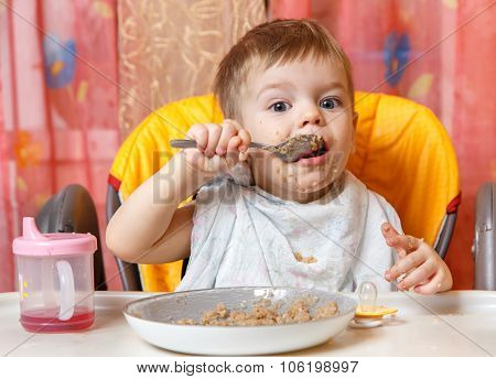 Little Boy Eats Buckwheat Cereal By Himself