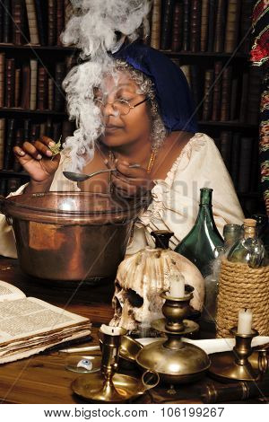 Halloween wizard adding herbs to a smoking cauldron