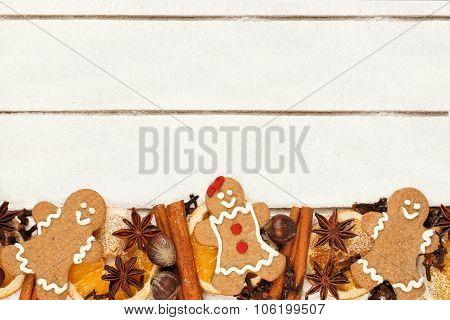 Christmas baking bottom border against white wood