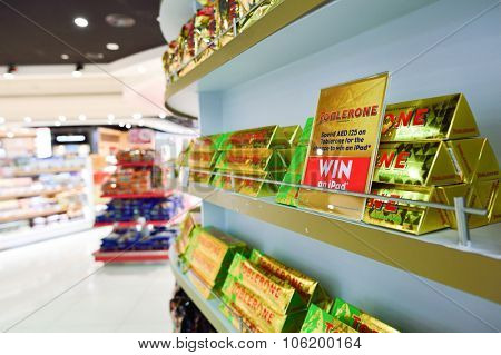 DUBAI - SEPTEMBER 08, 2015: close up shot of shelves with chocolate in Dubai Duty Free. Dubai Duty Free is the largest single airport retail operation in the world