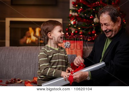 Happy Grandfather With Grandson At Christmas