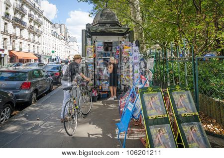 News stand on a street corner in Paris