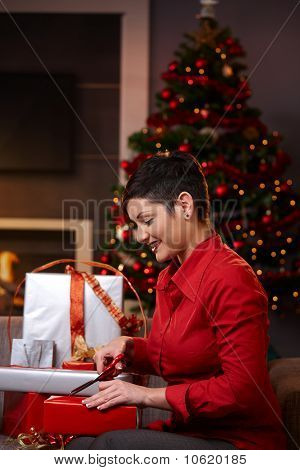 Young Woman Preparing For Christmas Eve