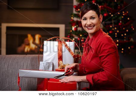 Happy Woman Wrapping Christmas Presents