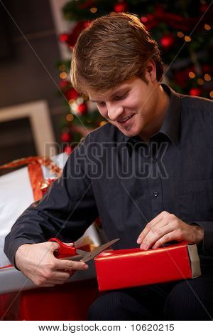 Young Man Preparing For Christmas Eve