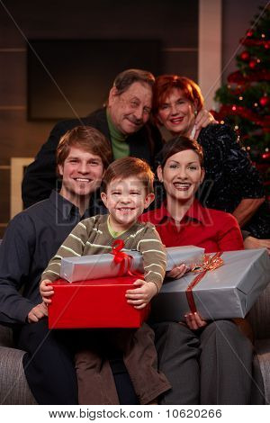 Happy Family With Grandparents At Christmas
