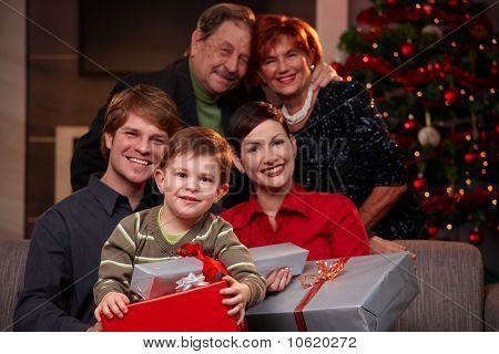 Happy Child Holding Christmas Gifts