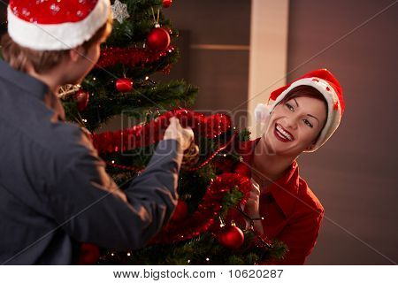 Happy Couple Decorating Christmas Tree