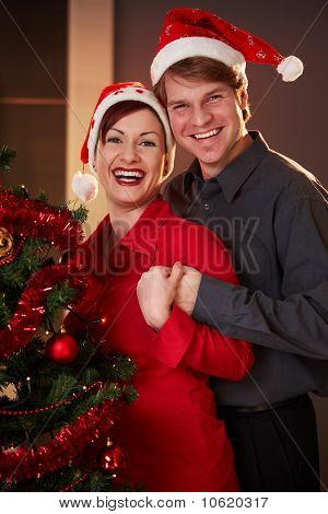 Young Couple At Christmas Eve