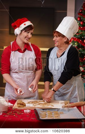 Mum And Daughter At Christmas Baking